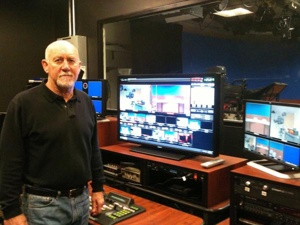 JACK PEAK, host of Manchester Review, stands in the Cox Public Access studio where he tapes the show.