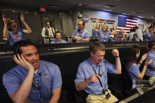NASA scientists at the Jet Propulsion Laboratory in La Canada-Flintridge celebrate the landing of the rover Curiosity on Mars.