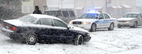 A car slid off the road and into the median of the Dual Highway on Wednesday morning. Snow, sleet and freezing rain made roads slippery.