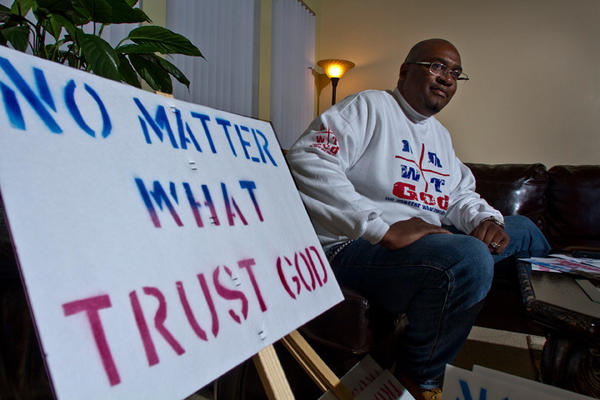 "Peter Person of Newport News is the man responsible for the ""No Matter What Trust God"" signs you see in our area of Hampton Roads.  He has gone on the road to distributed hundreds of the signs to Newtown, Conn."