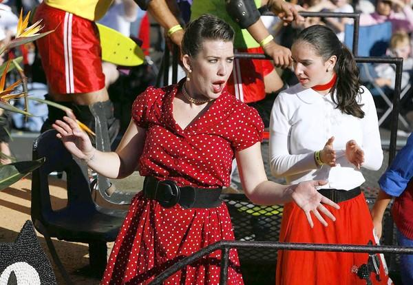 "Lauren Anne Clement, left, and Rashell Khalsin, right, dance on the Kit-Cat Clocks float, ""Timeless Fun For Everyone,"" during the Rose Parade."