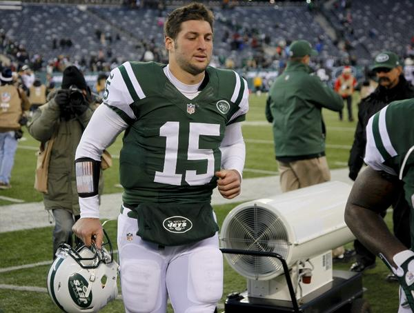 Tim Tebow walks off the field after the Jets' loss to the San Diego Chargers on Sunday.