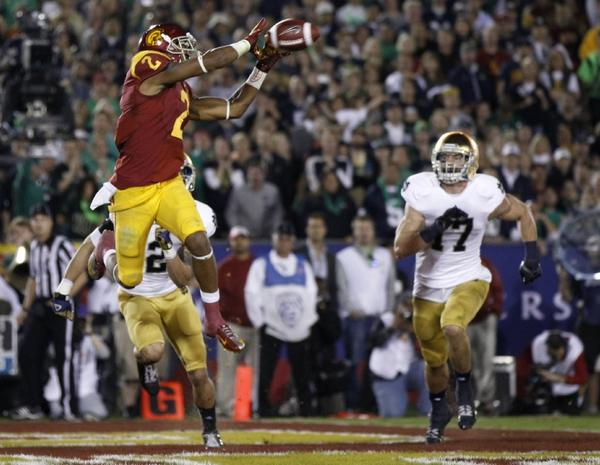 USC wide receiver Robert Woods catches a touchdown pass from quarterback Max Wittek on Nov. 24.