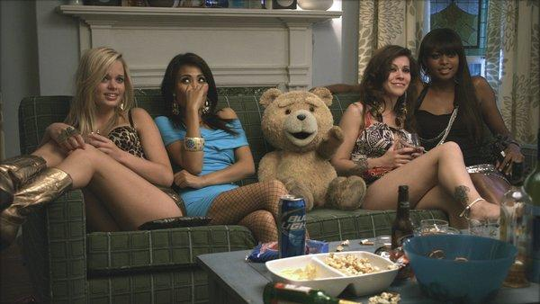 "The talking bear character Ted (voiced by Seth MacFarlane) relaxes with hookers in the movie ""Ted."""