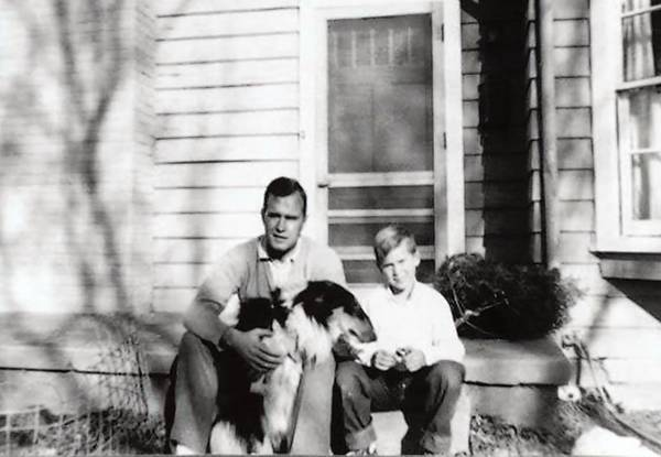 Two future U.S. presidents, George H.W. Bush and his son George W. Bush, 7, sit on the porch in front of their home in Midland, Texas. The house has been restored and is open to the public.