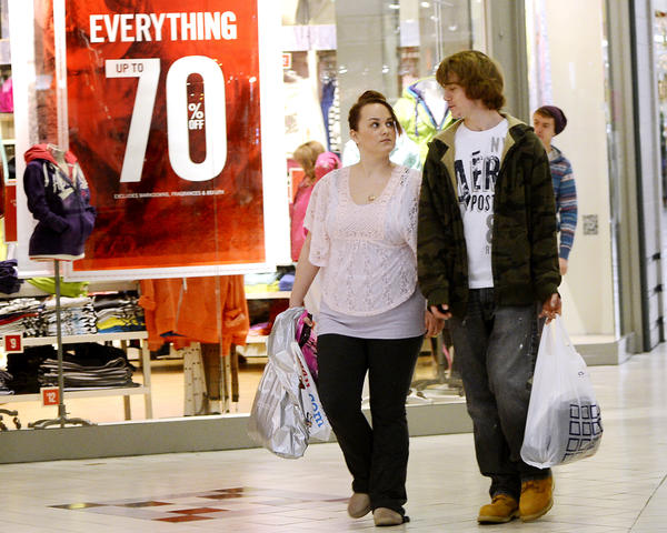 Nick McCallaster, right, and Nikki Bell, left, work on their second load while shopping at the Valley Mall on Wednesday for after Christmas sales.