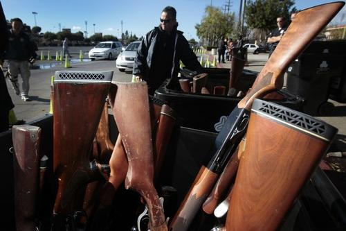 Thousands of people exchanged their guns for gift cards Wednesday at the Los Angeles Memorial Sports Arena. Rifles, shotguns, handguns as well as assault weapons were sold to the Los Angeles Police Department in an annual event that was moved up in the wake of the recent school shooting in Connecticut.