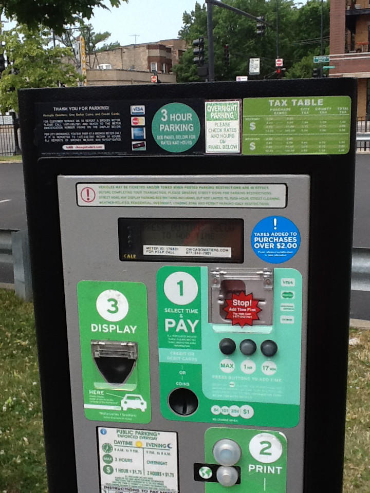 A parking meter at a lot at Western and Lincoln near the CTA Brown Line station.