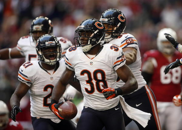 The Bears had to have this one to keep their playoff hopes alive. A pair of defensive TDs led the way, including one by Zack Bowman (pictured). Now, if only they could keep this up through the Super Bowl. RECORD:9-6