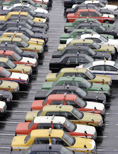 Taxis wait for their customers at the Tokyo International Airport