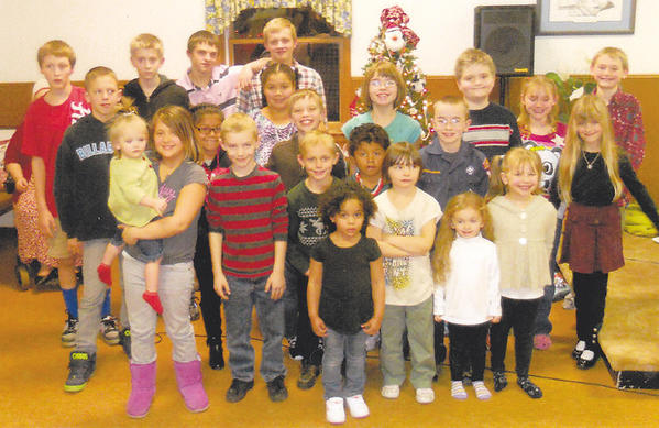 Young members of the Waynesboro, Pa., Seventh-day Adventist Church with some of their friends from the community. Front row, from left, Mia Vaughn, held by Natelie Rhone, Tanner Barvir, Carter Vaughn, Raygen Cooper, Mario Valazquez, Samantha Northrup, Jazymin Ward and Nevayah Nieve. Second row, Payton Bailey, Selena Valazquez, Nicole Valazquez, Layne Vaughn, Michael Northrup and Chelsea Wigington. Third row, Ryan Flohr, Connor Garvin, Skylar Koons, Loden Vaughn, Kelsey Murray, Duncan Garvin, Cordelia Redding and Ethan Redding.