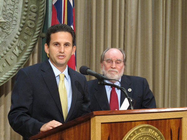 Hawaii Lt. Gov. Brian Schatz speaks at the state Capitol in Honolulu on Wednesday after Gov. Neil Abercrombie, right, announced he was appointing Schatz to fill the seat vacated by the late U.S. Sen. Daniel K. Inouye.