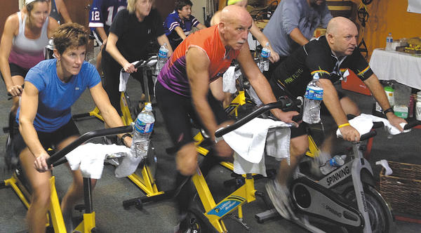 From left, Sue Fahey, Dave Ruff and Dan Greenwald cycle during the Suffer for a Cause fundraiser. Erin Ruff founded the Kisseman Children's Foundation after spending a summer abroad at the University of Ghana. The money raised from the cycling marathon will go to help the children of Kisseman Village, Ghana.