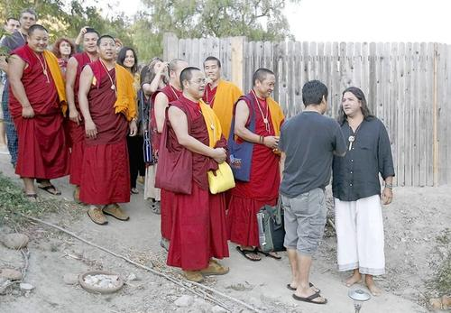 Native American Andrew Soliz, far right, welcomes a group of seven monks from Loseling Phukhang Monastery in southern India to his teepee tent at his home in Laguna Beach on Sept. 19.