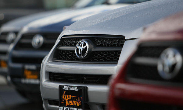 The Toyota logo is displayed on the grill of brand new Toyota RAV4s on the sales lot at City Toyota in Daly City, California.