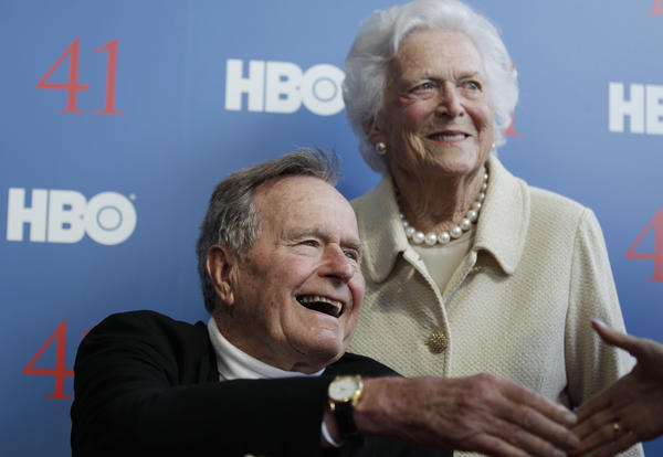 In a June 12 file photo, former President George H.W. Bush, and his wife, former first lady Barbara Bush, arrive for the premiere of HBO's new documentary on his life near the family compound in Kennebunkport, Maine. The 41st president, hospitalized since Nov. 23, continues to recover at a Houston hospital where he's being treated for a bronchitis-related cough.