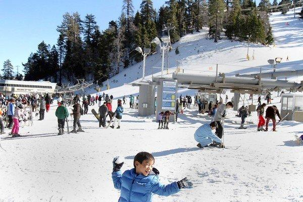 Andrew Kim, 5, has some snow fun at the Mountain High ski area the day before Christmas. Recent storms have dropped enough snow to build a 20-inch base at the resort near Wrightwood.