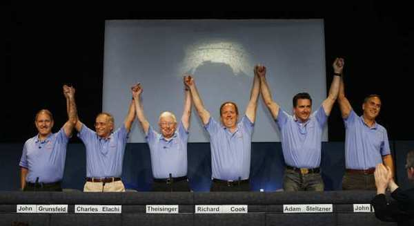 A proud lead team of John Grunsfield, Charles Elachi, Pete Theisinger, Richard Cook, Adam Steltzner and John Grotzinger, triumphantly raise their hands at JPL after the rover Curiosity successfully landed on the Red Planet.