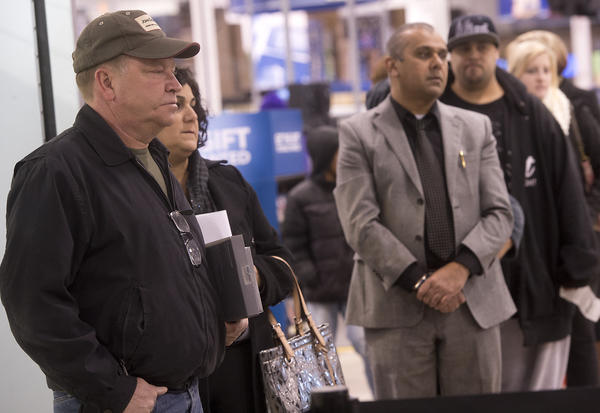 Rick Hughes of Orefield waits in line to return a Nook he got for Christmas, at Best Buy in Whitehall on Wednesday. Hughes said he got two fir Christmas. He was among millions of shoppers nationwide who returned to stores today the day after Christmas.
