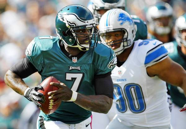Quarterback Michael Vick #7 of the Philadelphia Eagles looks to pass as Ndamukong Suh #90 of the Detroit Lions closes in during the first half in a game at Lincoln Financial Field on October 14, 2012 in Philadelphia, Pennsylvania.