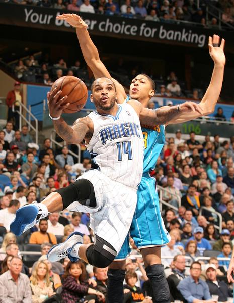 Orlando guard Jameer Nelson (14) scores in front of New Orleans forward Anthony Davis (behind) during the New Orleans Hornets at Orlando Magic NBA game at the Amway Center on Wednesday, December 26, 2012. New Orleans won the game 97-94.