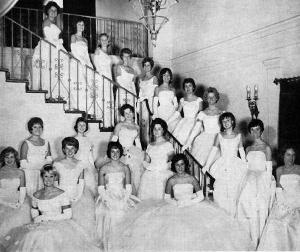 Twenty Les Fleurettes debutantes of the La Cañada Thursday Club prepare to make their 1962 debut at the Bal Blanc de Noel in the Viennese Room of the Huntington-Sheraton Hotel, today the Langham Huntington, in Pasadena. Front row, left to right: Pamela Ann Gregory, Sharon Sammann, Janet Olena Hammond, Pamela Ann Frase, Shirley Jean Sutton, Cheryl Anne McLean, Patricia Irene Buttress, Mary-Beth Mercer and Claudia Sue Murphy. From the top of the stairway: Diedri Sue Updegraff, JoNell Brown, Jann Mary Manchester, Katherine Ann Joes, Cleata Ann McIntosh, Laura Leigh Johnston, Kathryn Amelia Gamble, Ellen Crhistina Brinkman, Pamela Clatworthy, Nancy Hamilton Abel and Ellen Thomas.
