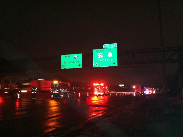 Firefighters block off I-78 in Upper Macungie Township late Wednesday as ambulance crews tend to at least four people injured in a 9:45 p.m. crash in the freezing rain.