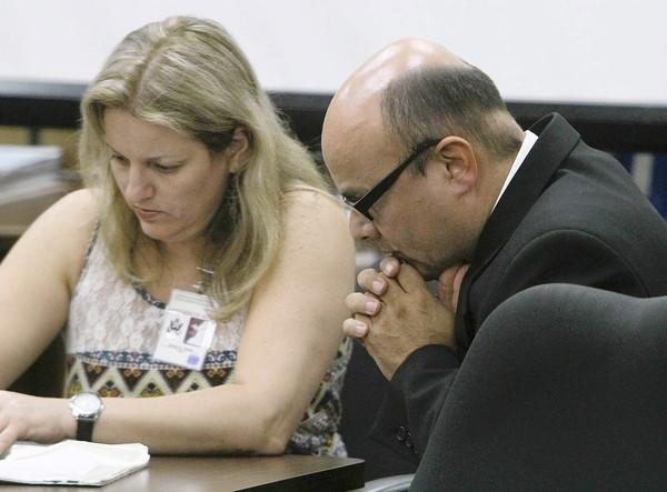 Truck driver Marcos Costa listens to court-appointed interpreter Teresa Krakow during his trial in 2011.