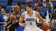 If Magic center Nik Vucevic wants to become a solid center, he is going to have to spend time in the weight room and looking at Dwight Howard video archives.