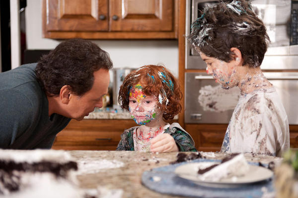 "Billy Crystal, as Artie Decker, Kyle Harrison Breitkopf, as Barker Simmons and Joshua Rush, as Turner Simmons, star in ""Parental Guidance,"" which opened on Tuesday."