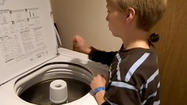 10-year-old plays the washing machine