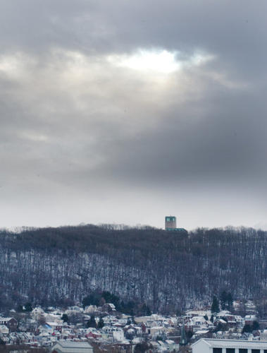 Flurries continued on Thursday morning in the Lehigh Valley as people clean up after Wednesdays snowfall. A break in the winter weather might be indicated as clouds open up above Bethlehem's South Mountain.