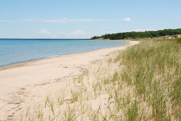 Critical dunes, like these seen at Sturgeon Bay in Cross Village Township in a June file image, require a permit from Emmet County to build on, but that ordinance is expected to be repealed next week.