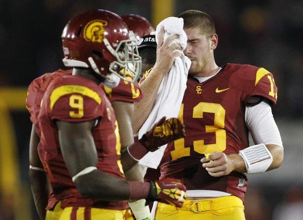 USC quarterback Max Wittek, right, wipes his face as wide receiver Marqise Lee stands nearby during a game in November.