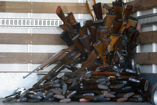 A small portion of guns that were turned in by their owners are stacked inside a truck at a gun buyback held by the Los Angeles Police Department. The program normally occurs in May but Los Angeles mayor Antonio Villaraigosa accelerated the schedule in response to the December 14 shooting that left 20 children and eight adults dead in Newtown, Conn.