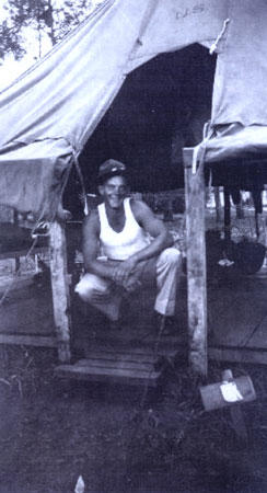 John H. Minnich in his tent at Wheeler Field on Oahu, Hawaii, in 1941.