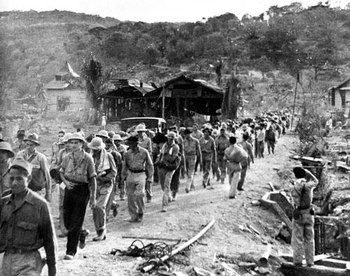 American and Filipino soldiers captured by the Japanese when Bataan fell on April 9, 1942, are shown at the start of the Death March.