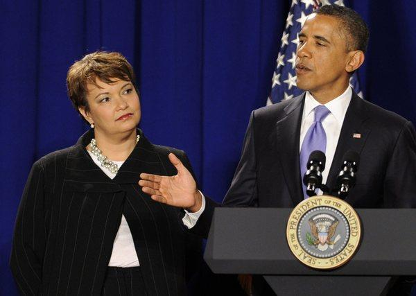 President Obama alongside departing Environmental Protection Agency Administrator Lisa Jackson.