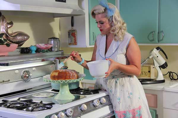"Dollie is one of the happy homemakers who live their present-day lives like it was still the 1950s in the new special ""Wives With Beehives,"" at 10 p.m. on TLC."