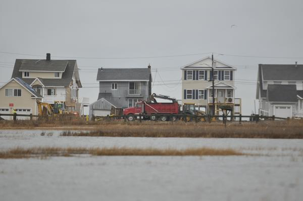 Some localized coastal flooding in East Haven. Construction continues on Caroline Road as residents recover from Sandy.