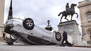 A car that crashed near the Washington Monument onl Thursday morning overturned, injuring a passenger and damaging a wall at the historic Mount Vernon park.