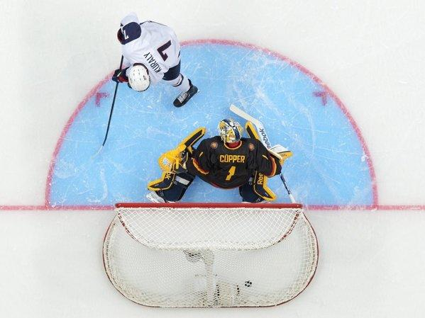 U.S. forward Sean Kuraly scores past Germany goalie Marvin Cupper during the first period.