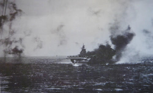 "The carrier Intrepid burns Nov. 25, 1944, after a kamikaze attack. Radarman Warren 'Jake' Fegely was in the command post inside the ship's island. Today, <a class=""taxInlineTagLink"" id=""PEPLT000857"" title=""George W. Bush"" href=""/topic/politics/government/presidents-of-the-united-states/george-w.-bush-PEPLT000857.topic"">President Bush</a> will attend a <a class=""taxInlineTagLink"" id=""EVFES000170"" title=""Veterans Day"" href=""/topic/unrest-conflicts-war/wars-interventions/veterans-day-EVFES000170.topic"">Veterans Day</a> ceremony aboard the carrier, now the recently reopened Intrepid Sea, Air & Space Museum in <a class=""taxInlineTagLink"" id=""PLGEO100100800000000"" title=""New York"" href=""/topic/us/new-york-PLGEO100100800000000.topic"">New York</a>."