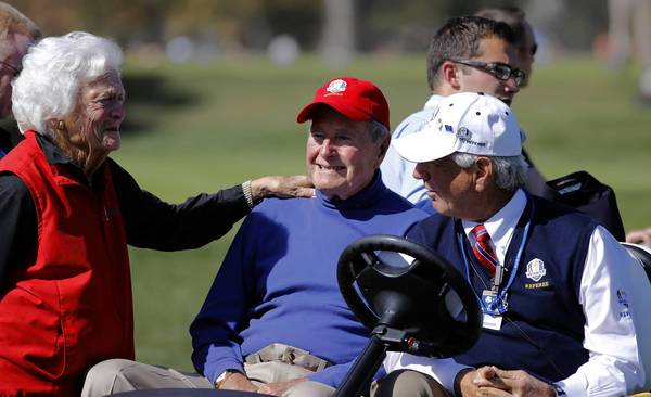 Barbara and former President George H.W. Bush attend the afternoon session of the second day of the Ryder Cup at Medinah Country Club in Medinah, Illinois.