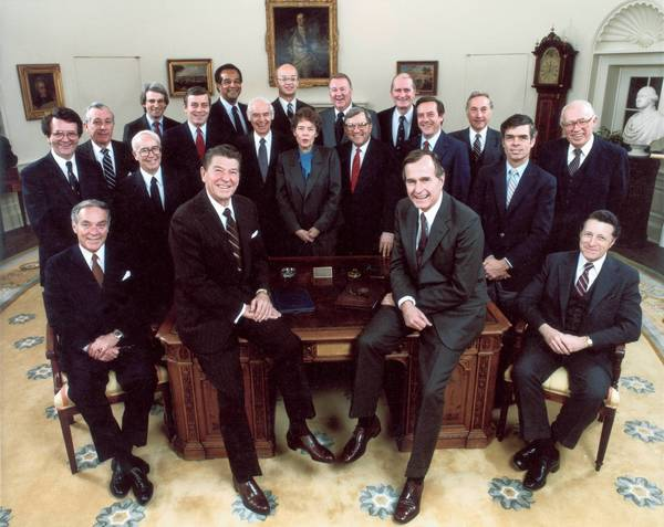A group portrait of Republican United States President Ronald Reagan (second L) with his cabinet members, Washington, DC. Included in the photo are Vice President George Bush (second R), Caspar Weinberger, James A Baker lll, George P Shultz, Edwin A Meese lll, Elizabeth Dole, Howard Henry Baker Jr, William J Bennet, John S Herrington, Clayton Yeutter, James C Miller lll, Malcolm Baldridge, and William Brock lll.