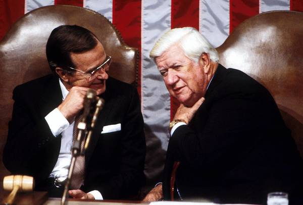 "Vice President George H.W. Bush (L) and House Speaker Thomas P. ""Tip"" O'Neill attend President Ronald Reagan's second State of the Union address January 1982 in Washington, D.C."