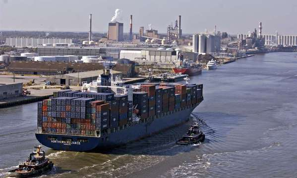 A container ship approaches a cargo terminal at Georgia Ports Authority in Savannah. The nation's fourth-busiest harbor is one of the seaports that would be idled if dockworkers strike along the East and Gulf coasts.