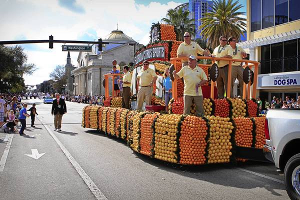The Florida Citrus Sports Foundation MVPS float passes Washington Street during the Fresh from Florida parade in downtown Orlando, Fla. on December 31, 2011.