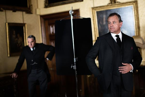 "Jim Carter, left, and Hugh Bonneville pause during filming of Season 3 of ""Downton Abbey."""