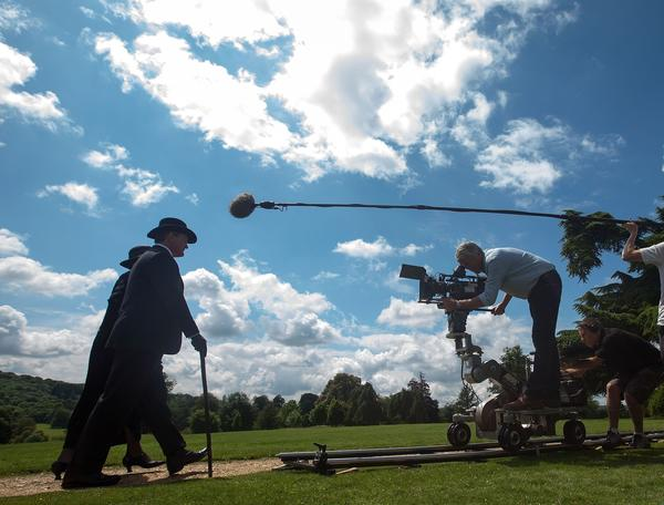 Elizabeth McGovern and Hugh Bonneville shoot a scene on the grounds of Highclere Castle, standing in as Downton Abbey, for the hit period drama.